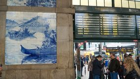 Porto, Portugal, circa 2018: Traditional Portuguese painted tiles azulejos depicting Portuguese history inside the Porto Train Sta. Tion Royalty Free Stock Photography