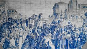 Porto, Portugal, circa 2018: Traditional Portuguese painted tiles azulejos depicting Portuguese history inside the Porto Train Sta. Tion Royalty Free Stock Images