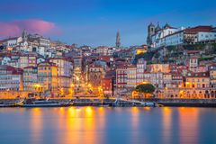Porto, Portugal. Cityscape image of Porto, Portugal with reflection of the city in the Douro River during sunrise royalty free stock photos