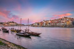 Porto, Portugal. Cityscape image of Porto, Portugal with reflection of the city in the Douro River during sunrise stock photography