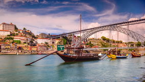 Porto, Portugal Cityscape on the River. PORTO, PORTUGAL - SEPTEMBER 29, 2014: Rabelo Boats float on the Douro River adorned with flags of local Wineries. The stock footage