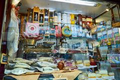 PORTO, PORTUGAL - December 9, 2018: Portuguese dried and salted cod fish bacalhau, cheese, canned and port wine at local store