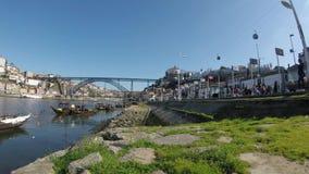 A view of Rabelo Boats and Ponte Luis Bridge at Douro River. PORTO, PORTUGAL - FEB 14: Famous Porto wine Rabelo Boats at Douro River , Portugal 2018 stock video footage