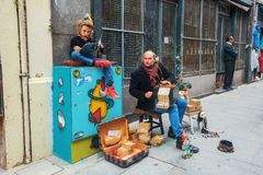 Street musicians on the one of the streets in the old downtown. Stock Photography