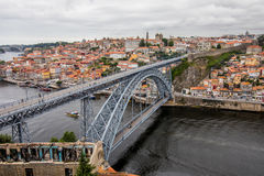 Porto, Portugal - July 2017. View of the iconic Dom Luis I bridge crossing the Douro River, and the historical Ribeira and Se Dist royalty free stock photography