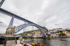 Porto, Portugal - July 2017. View of the iconic Dom Luis I bridge crossing the Douro River, and the historical Ribeira and Se Dist. View of the iconic Dom Luis I Royalty Free Stock Images