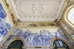 PORTO, PORTUGAL - JUNE 24, 2017: Ancient vintage Azulejos panel on inside walls of main hall of Sao Bento Railway Station in Porto. City. Tiles Installed Royalty Free Stock Image