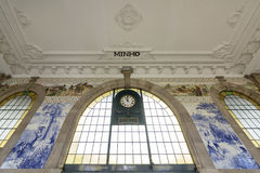 PORTO, PORTUGAL - JUNE 24, 2017: Ancient vintage Azulejos panel on inside walls of main hall of Sao Bento Railway Station in Porto. City. Tiles Installed Royalty Free Stock Images