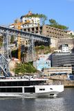 From the embankment of the Douro River sails pleasure boat with tourists. stock photo