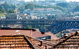 Porto, Portugal – May 2, 2019: Picturesque view of colorful old houses and famous metal Luis I bridge in the ancient city Porto. Porto, Portugal royalty free stock images
