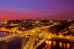 Porto, Portugal. Night landscape, Luis I Bridge through the river Douro, Porto, Portugal royalty free stock images