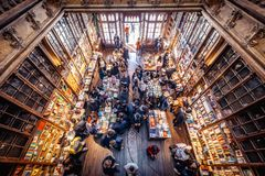 Lello bookstore in Porto city. Porto, Portugal - November 13, 2017: Customers and tourists in famous Lello Bookstore in Porto, considered to be one of the most Stock Photos