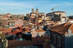 View of Ribeira with  Se Do Porto in Porto, Portugal. PORTO, PORTUGAL - OCTOBER 31, 2017: View of Ribeira with  Se Do Porto on a horizon top, old roman cathedral Stock Photo