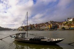 Porto, Portugal old town cityscape on the Douro River with traditional Rabelo boats. stock image