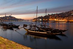 PORTO, PORTUGAL - 07.10.2016, old town cityscape on the Douro River with traditional Rabelo boats, with barrels advertising Porto Stock Photography