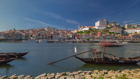 Porto, Portugal old town skyline on the Douro River with rabelo boats timelapse hyperlapse. Porto, Portugal old town skyline on the Douro River at day with stock video