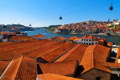 Porto, Portugal old town skyline with orange rooftops from vila nova de gaia on the Douro River. In sunny day stock photography