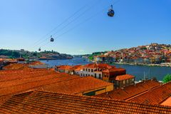 Porto, Portugal old town skyline with orange rooftops from vila nova de gaia on the Douro River