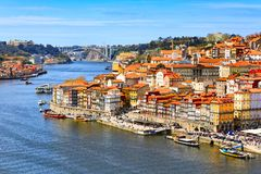 Porto, Portugal old town view with Douro river. Porto, Portugal old town ribeira aerial promenade view with colorful houses, Douro river and boats royalty free stock photos