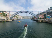 2016 09 Porto, Portugal: One flew over the Douro river and boat Royalty Free Stock Photos