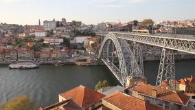 Porto, Portugal: overview of iconic Dom Luis I bridge over Douro river, and historical downtown district of La Ribeira stock video footage
