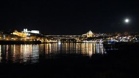 Porto, Portugal: Panoramic night view of the historic cityand famous Dom Luiz bridge, and their reflections over Douro river stock footage