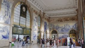 Porto, Portugal Sao Bento train station with crowd and Azulejo tiles decoration. stock footage