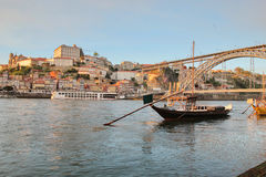 Porto, Portugal: sunset view of Dom Luis bridge and the Ribeira quarters Royalty Free Stock Photo