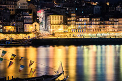 Porto, Portugal. View of the Old Town. Night cityscape. Douro river with the traditional Rabelo boats in the night the light of la Stock Photo