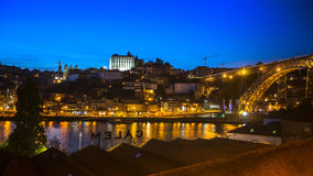 PORTO, PORTUGAL -  View of Porto and the Dom Luiz bridge at night time. Royalty Free Stock Photography