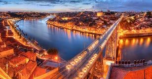 Porto, river Duoro and bridge at night. Panorama of lighted  famous bridge Ponte dom Luis above  Old town Porto and  river Duoro at night, Portugal Royalty Free Stock Photo