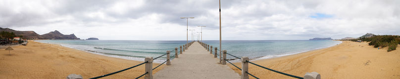 Porto Santo beach. Golden sand of Porto Santo beach as seen from the beginning of the pier under overcast sky. Madeira, Portugal Stock Photography