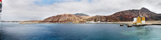 Porto Santo Harbour. Of blue waters under an overcast sky as seen from the ferry boat. Madeira, Portugal Royalty Free Stock Image