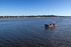 Porto Seguro coast and boat navigating. On Buranhem river in Bahia - Brazil Stock Image