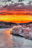 Porto at sunset orange. HDR of Porto from Dom Luis bridge Stock Photos