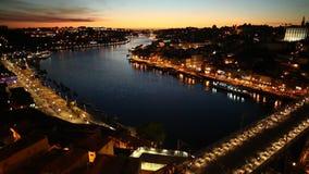 Porto sunset skyline. Aerial view of Dom Luis I on Douro River at sunset from Miradouro da Serra do Pilar at Vila Nova de Gaia, Porto, Portugal. The iron arch stock footage