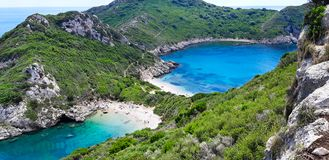 Porto Timoni, beach in Corfu. Famous 2 side Porto Timoni beach near Agios Georgios, Beautiful Paleokastritsa beach on Corfu, Cape Drastis with nearby islands stock image