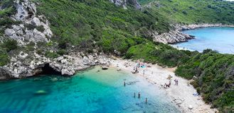 Porto Timoni, beach in Corfu. Famous 2 side Porto Timoni beach near Agios Georgios, Beautiful Paleokastritsa beach on Corfu, Cape Drastis with nearby islands royalty free stock photo