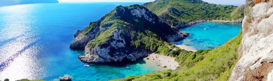 Porto timoni blue lagoon coast landscape ionian sea on Corfu isl. Porto timoni panorama of blue lagoon beach coast in the ionian sea landscape on Corfu island royalty free stock photo