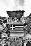 Porto Vromi tourist shelter near the beach with Greek flag Royalty Free Stock Image