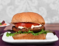 Portobello mushroom burger with goat cheese. Royalty Free Stock Photography