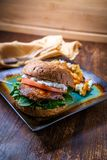 Portobello Mushroom Burger. Portobello mushroom sandwich with goat cheese pesto and side of Greek sweet potato fries royalty free stock photos