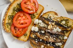 Portobello Mushroom Burger. Portobello mushroom sandwich with goat cheese and pesto royalty free stock photos