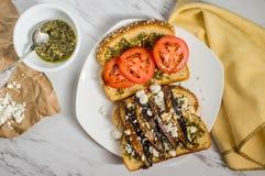 Portobello Mushroom Burger. Portobello mushroom sandwich with goat cheese and pesto royalty free stock photography