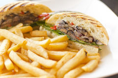 Portobello Mushroom Sandwich. On a toasted ciabatta bun and side of fries royalty free stock photo