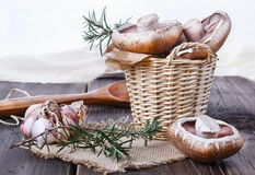 Portobello mushrooms in a woven basket Stock Images
