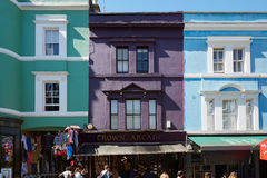 Portobello road colorful houses and people in London Stock Image
