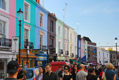 Portobello road London Notting hill England UK. Notthinghil with people walking on portobello road with colourful shops and houses Stock Photo