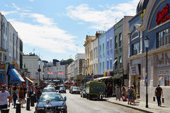 Portobello road with people walking in a sunny day in London Royalty Free Stock Images