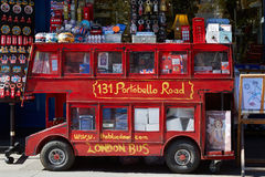 Portobello road souvenir shop with red London bus Royalty Free Stock Image